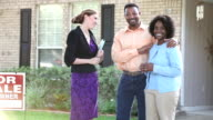 African American couple with realtor buying house video