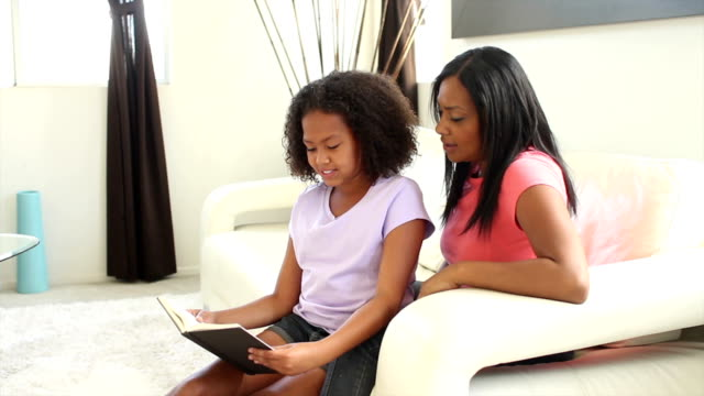African American Daughter Reads to Mother Finishes Book Proud video