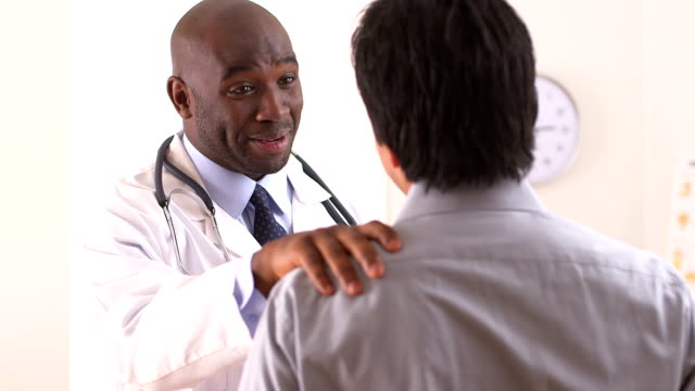 African American doctor talking to Hispanic patient video