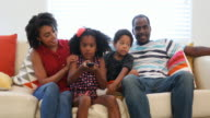 African American Family at Home Watching TV on the Sofa video