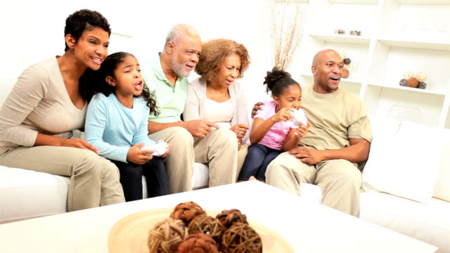 African American Family Playing Action Games Console video