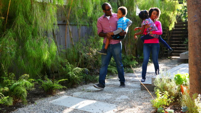 African American Family Walking Through the House Yard video