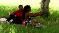 African American Family With Father Mother Child Hugging In Park video