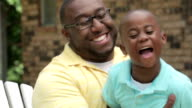 African American father and playing and laughing video