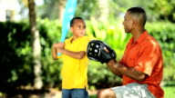African American Father & Son Practicing Baseball video