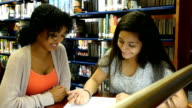 African American high school student tutors Middle Eastern high school student video