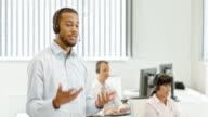 DS African American male helpline operator walking and talking video
