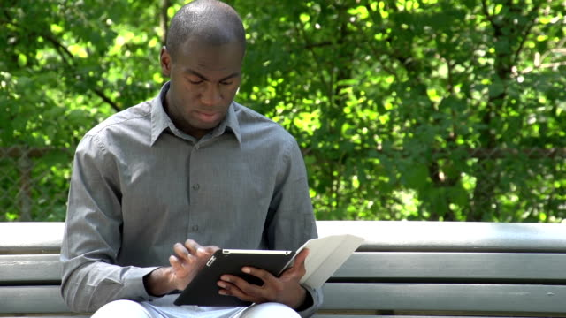 African American man at the park on his tablet video
