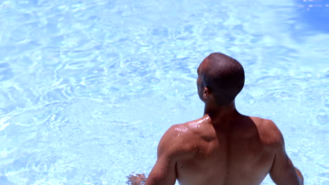 African American man standing in swimming pool video