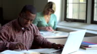 African American man studying video