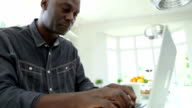 African American Man Using Laptop At Home video