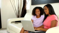 African American Mother and Daughter Shop Online Tracking Right video