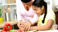 African American Mother Daughter Preparing Food Kitchen video