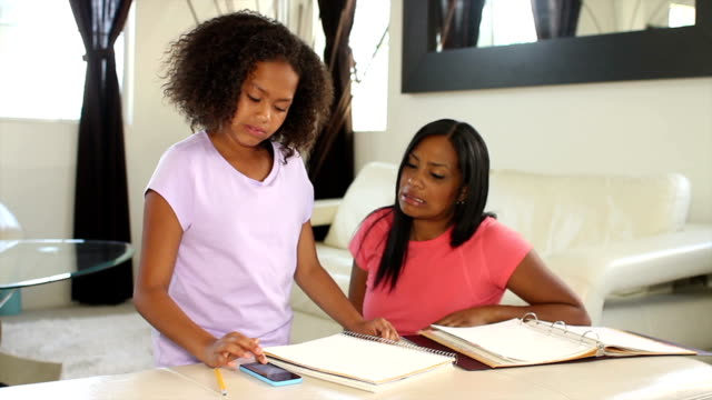 African American Mother Helping with Homework Track Right video