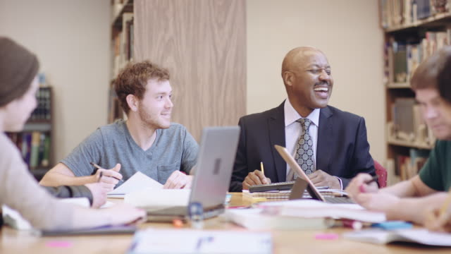 African American professor visiting with students video
