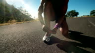 African American runner tying his shoelaces video