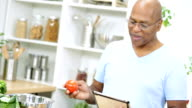 African American Senior Male Kitchen Wireless Technology Close Up video