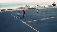 African American skateboarding in seaside parking lot video