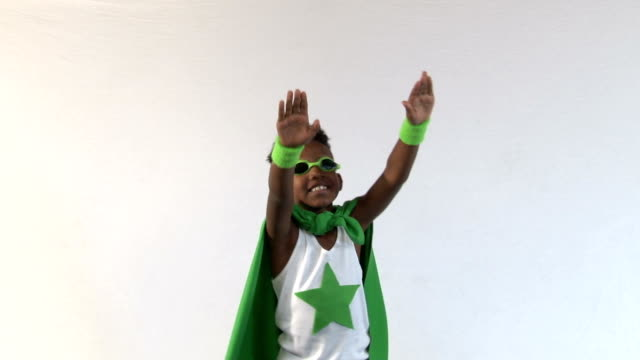 African American Super Hero Pretends to Fly video