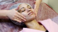 African american woman getting facial massage at spa salon video