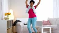 African American woman in jean vest dancing video