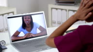 African American woman video chatting with doctor video