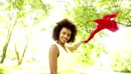 African American Woman waving red scarf video