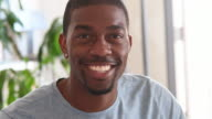 African American young man portrait smiling looking to camera video