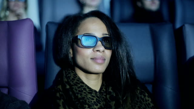 African american young woman is watching 3d cinema video