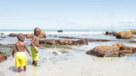 African boys fishing with nets on the beach video