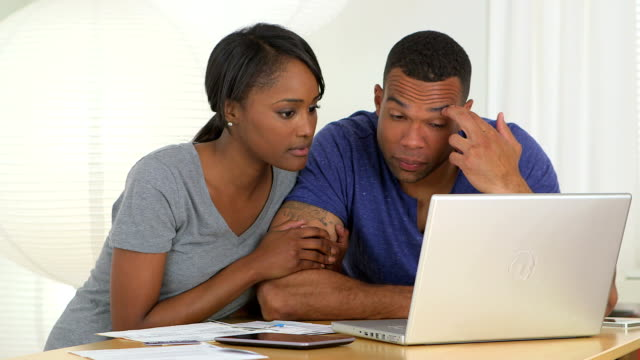 African couple going over finances video