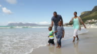 African family taking a walk on the beach video
