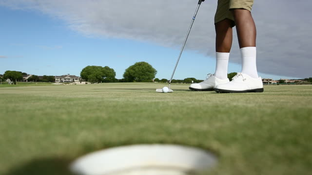 African golfer excited about hitting a ball into the hole video