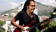 African Guitarist Playing Bass video