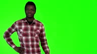African man pointing on green video