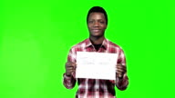 African man with thank you sign in hand video