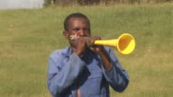 African Soccer Fan blowing Horn Vuvuzela - HD & PAL video