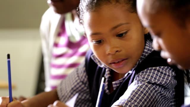 African Teacher and School Girls video