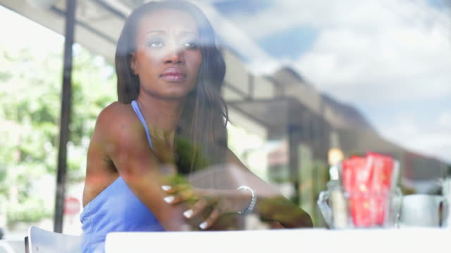 African woman waiting in coffee shop for her man video