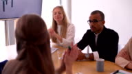 African-american businessman and business team high five in meeting room video
