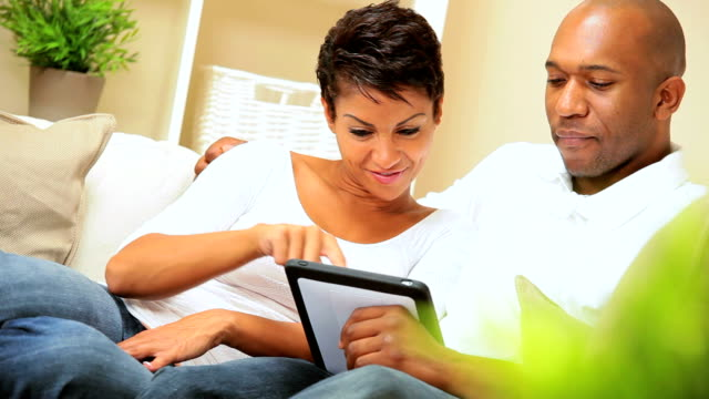 African-American Couple Using Wireless Tablet video
