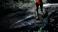 SLO MO African-American female running on a muddy trail at night video