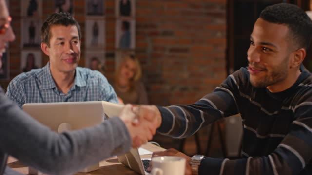 African-American man closing meeting with handshake video