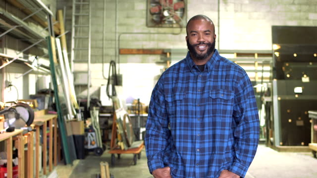 African-American man in plate glass warehouse video
