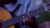 HD: African-american Man Playing Acoustic Guitar Outdoors. video