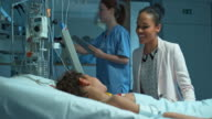 African-American mother visiting her son in the intensive care video