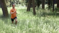 SLO MO DS African-American woman running in forest video