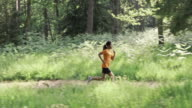 SLO MO DS African-American woman running through forest video