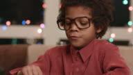 Afro boy using keyboard. video