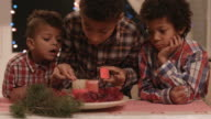 Afro children lighting Christmas candles. video